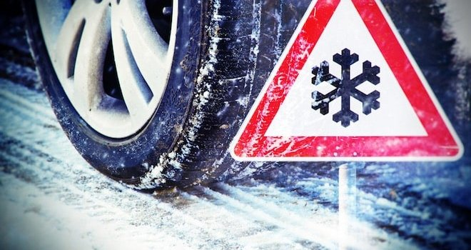 sign with snowflake and tire